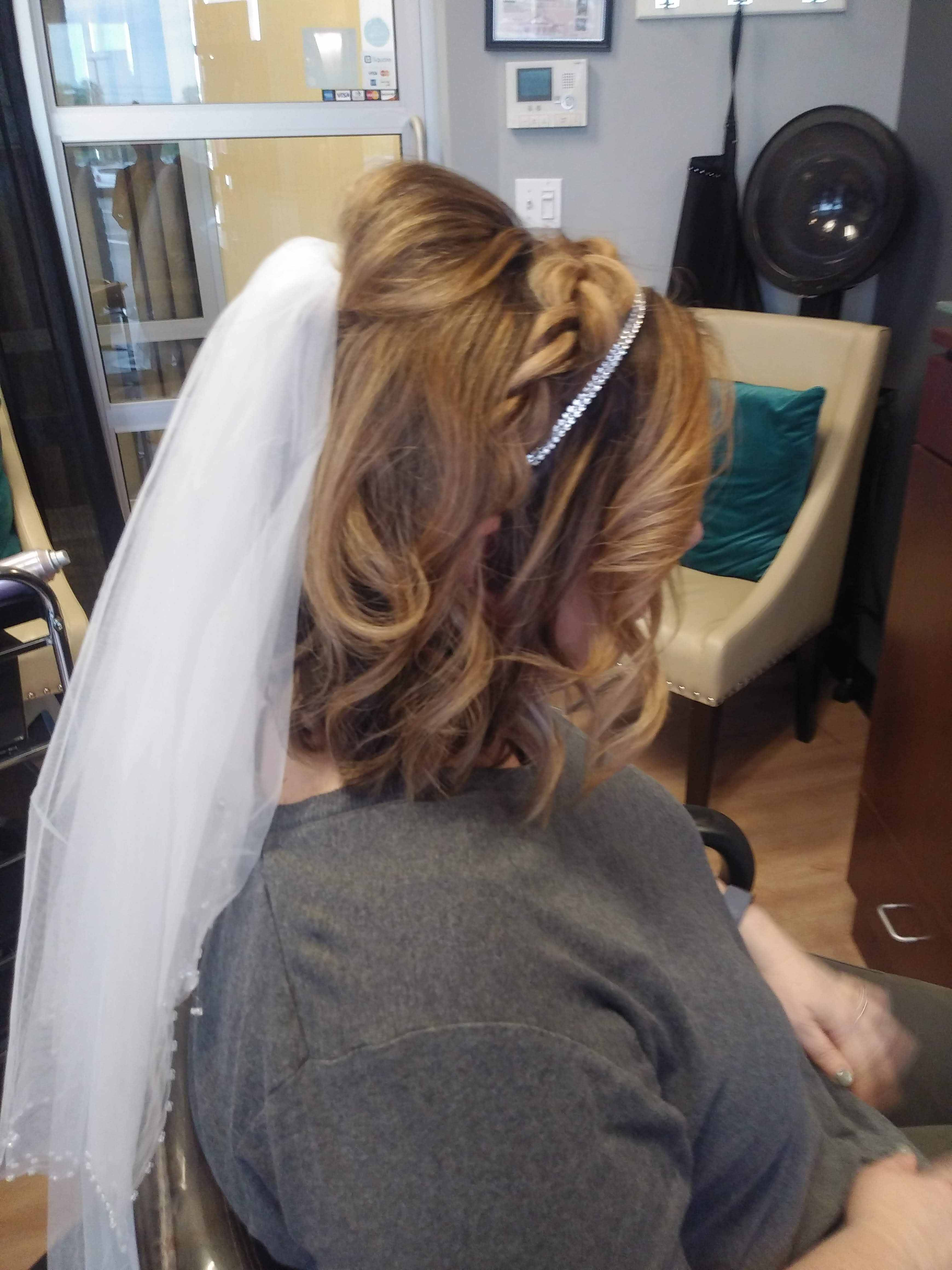 side view of wedding up-do with veil