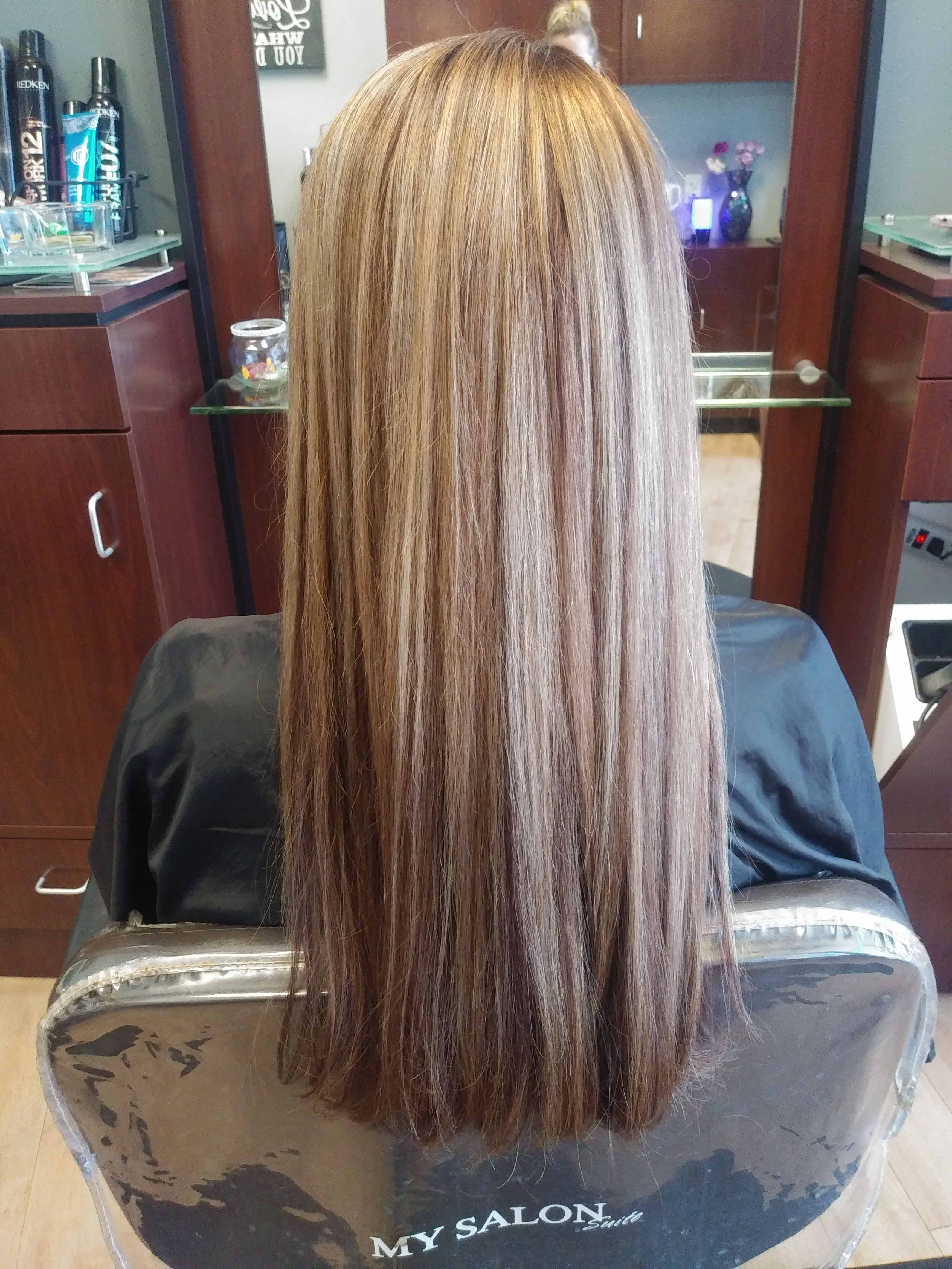 woman with long hair after highlights