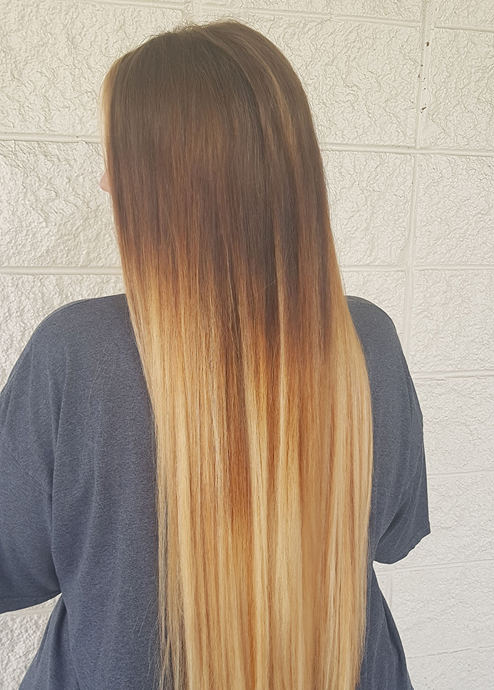 woman with long straight balayage